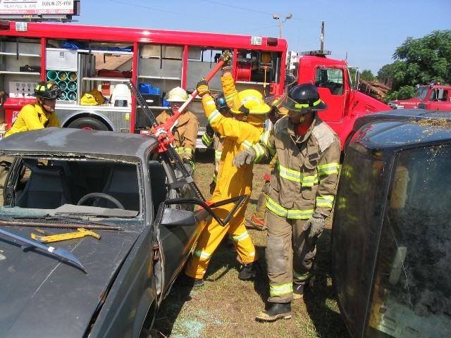 Firefighters Breaking Into the Vehicle