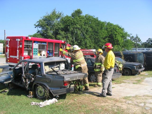 Firefighters Entering a Vehicle
